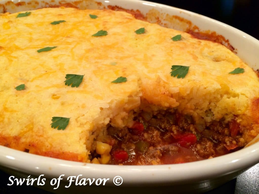 Cornbread Chili Casserole with a scoop out.