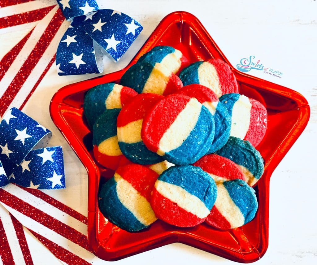 Red white and blue stripe sugar cookies on a red star-shaped dish