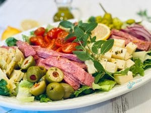 Chopped antipasto salad on white oval platter