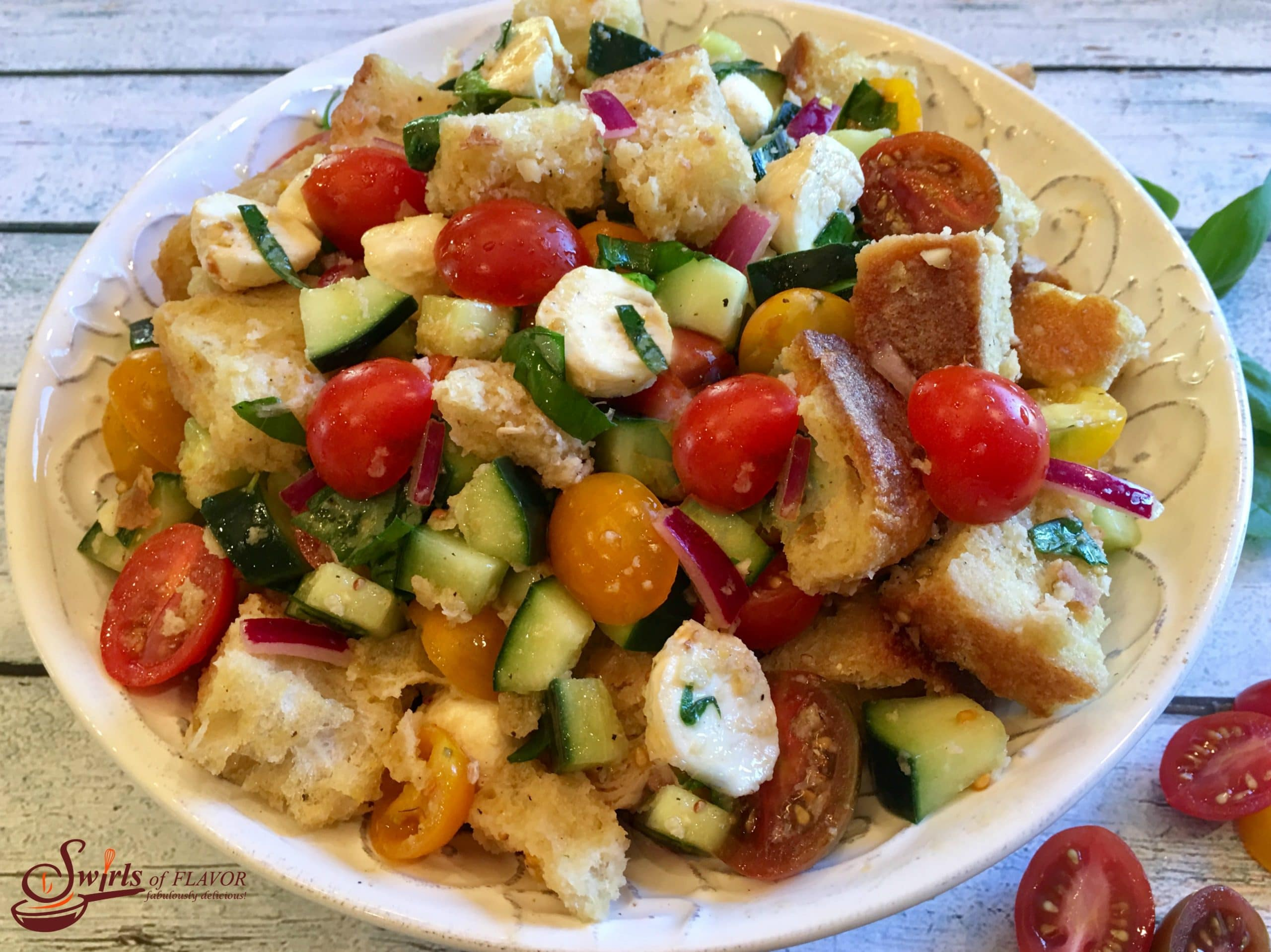 bread salad in a round serving dish