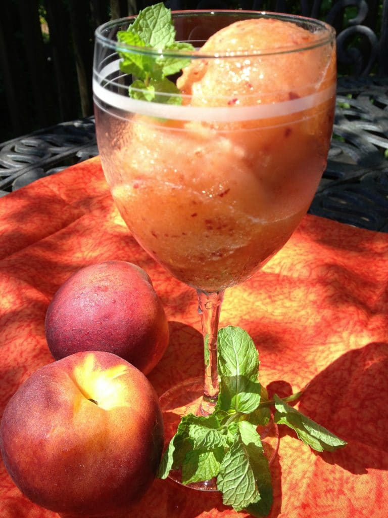 Frozen Peach Sorbet with fresh mint in wine glass