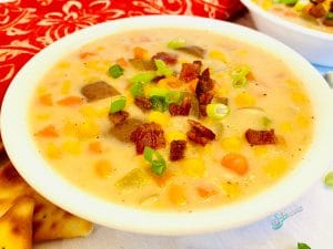 bowl of corn chowder topped with bacon