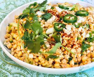 fresh corn salad in white bowl